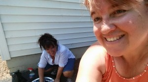Ali helping Sherri clean tires