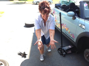 Sherri jacks up a car