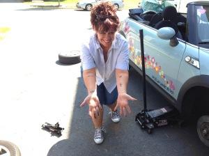 Sherri jacks up a car